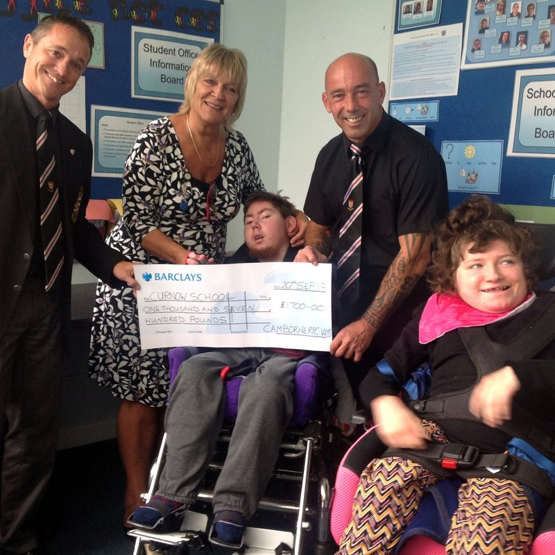 Vets Present Cheque to School.