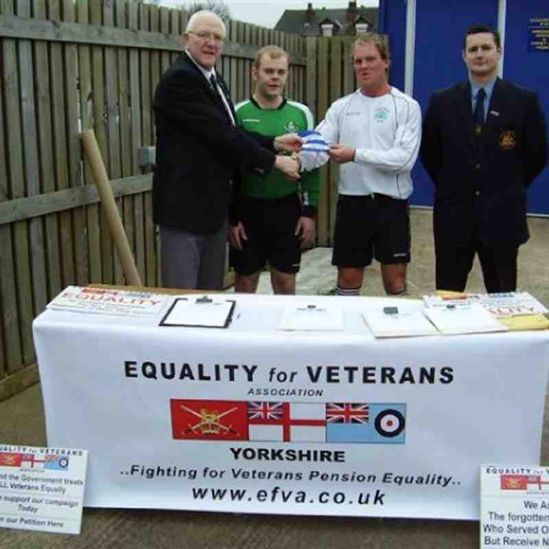 John Bailey presents team captains Chris Bragg and Gaz Jarrett with special EFVA armbands for the Cup Final.