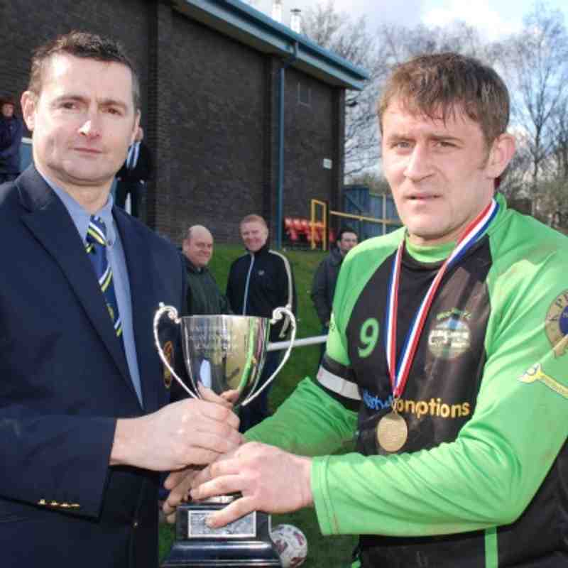 League Chairman Mr. Adie Wilkinson presents Woodman skipper Stu Bateson with the Division Four League Cup.