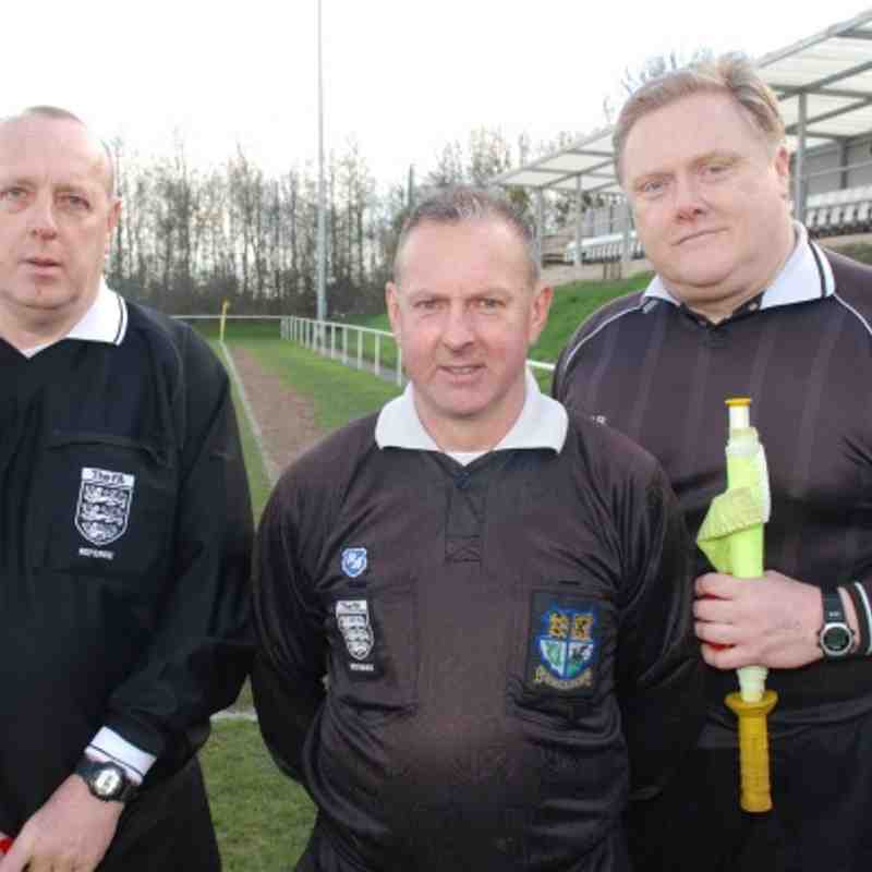 Division Four Cup Final Match Officials: (L to R) Brian Wilson, Andrew Fawcett (Referee) and Brian Wilkinson