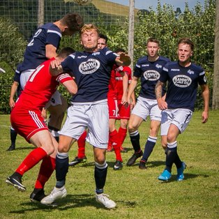 Ten man Llanfair hold onto a point