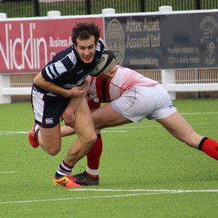 Lions Brave in Defeat to Leaders
