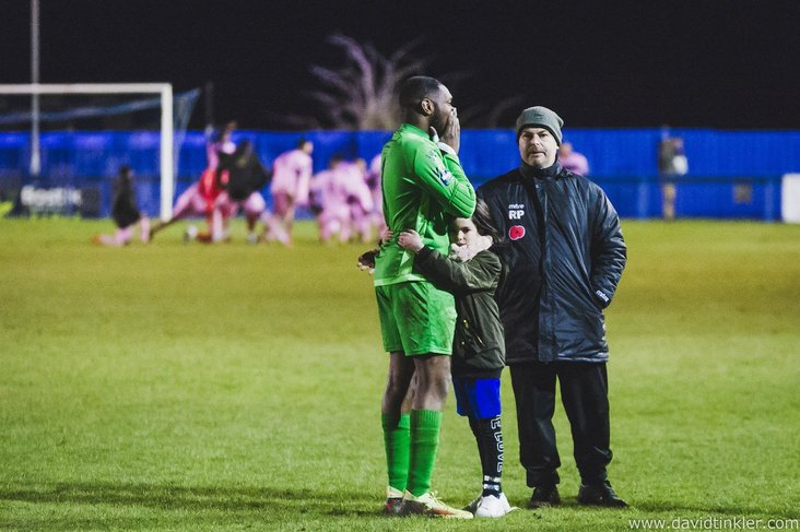 Brentwood Town keeper Anthony Page comforted after conceding a last gasp goal