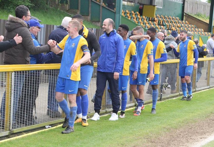 Romford captain Danny Cossington and team celebrate their great escape!