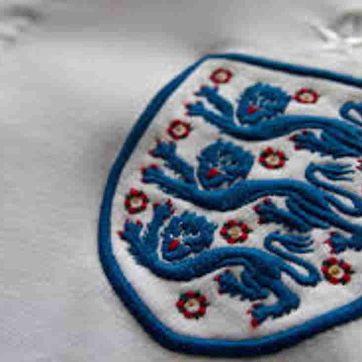 Three Lions on their shirts