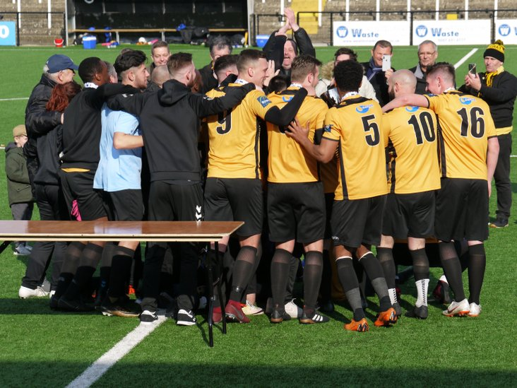 A trophy-winning huddle for Cray Wanderers