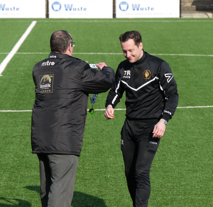 Wanderers manager Tony Russell gets deserved congratulations from League Chairman Nick Robinson