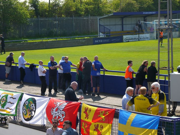Fans enjoy the sun before the match