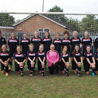 Girls beat high flyers and unbeaten league leaders in local rival clash