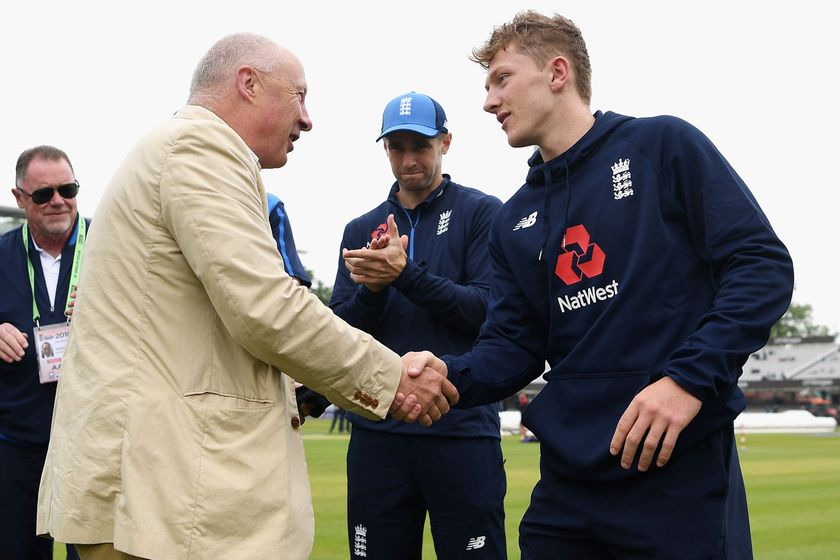 Vic Marks hands fellow Somerset spinner Dom Bess his Test cap