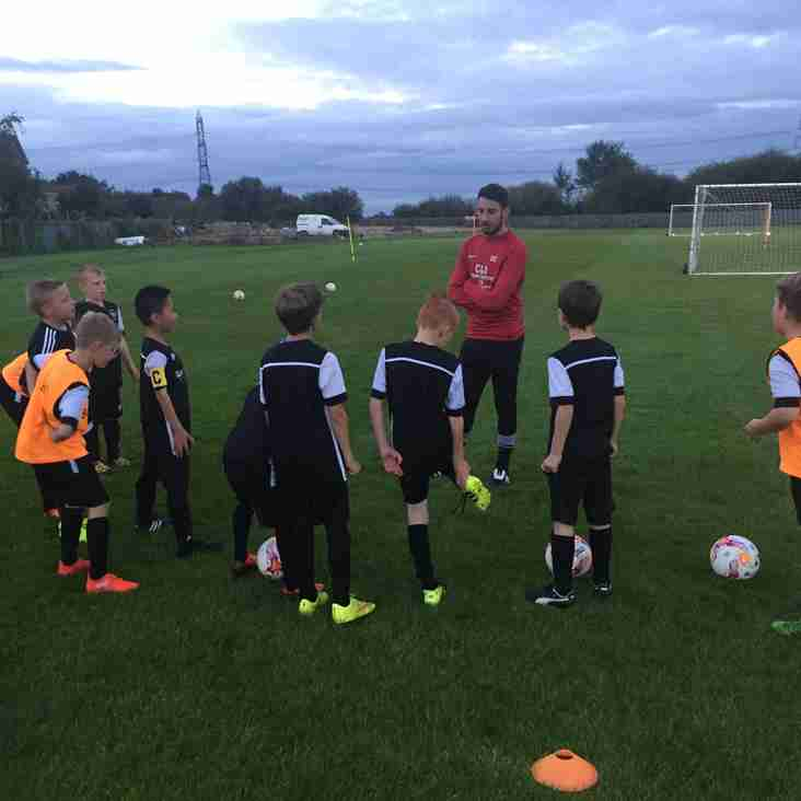 danny drops in on u10's training session