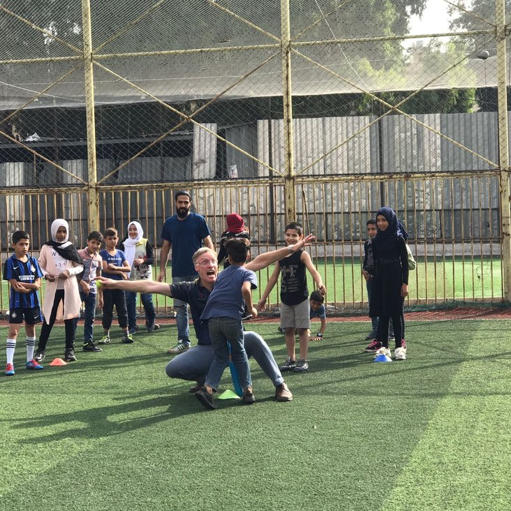 Richard Verity introducing cricket to Syrian refugees in Beirut<
