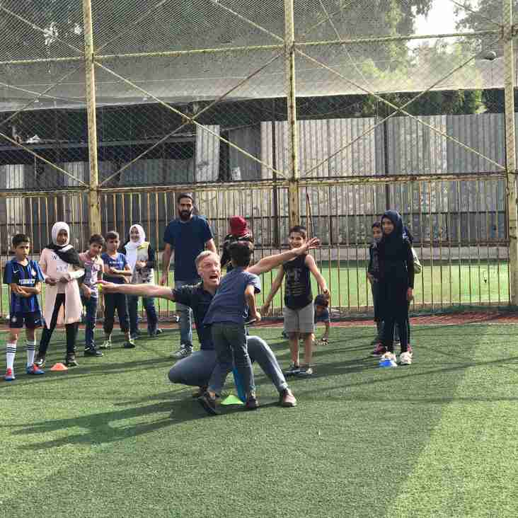Richard Verity introducing cricket to Syrian refugees in Beirut