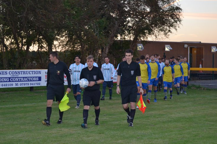 Martin Dempster leads the teams out