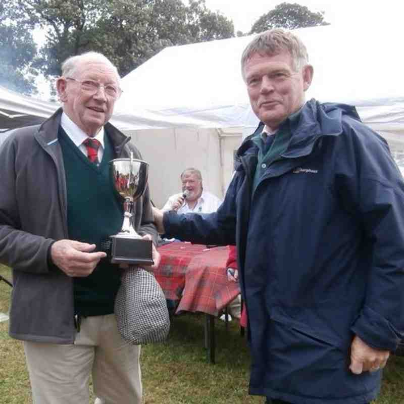 Alistair Urquhart receiving the Dr Donny Innes Cup, as the 2014 Festival  Oldest Player, from SRU President - Alan Lawson