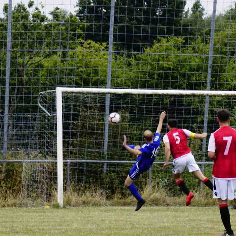 Mike Seeley's last ditch clearance vs Sikh Hunters (A) photo courtesy of Mathew Mason