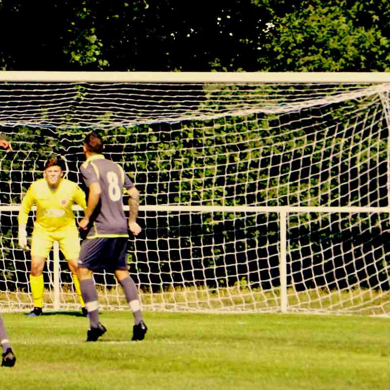 Mike Seeley challenging vs Darlaston Town (A) courtesy of Mathew Mason