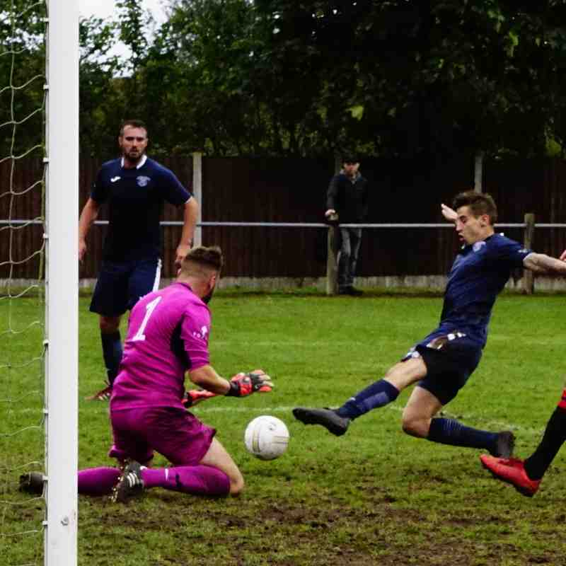 Town defend with Lemon in close attention vs Newport Town (A) photo courtesy of Mathew Mason