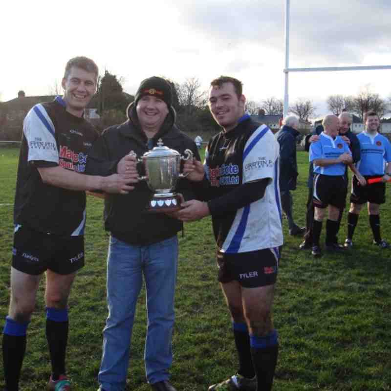 Captain Dave Bennett and Kris Parker being presented with the cup by Shaun from league sponsors GMB Union