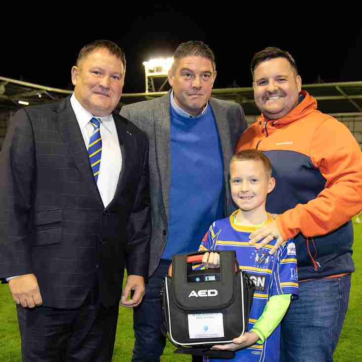 Warrington Wolves Foundation donate defibrillators to every local community club
