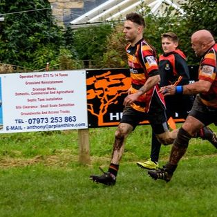 Clitheroe overcome Ashton in the mud.