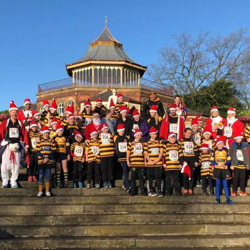 Santa Hats and Orrell Shirts ... Leading the way in the Santa Dash