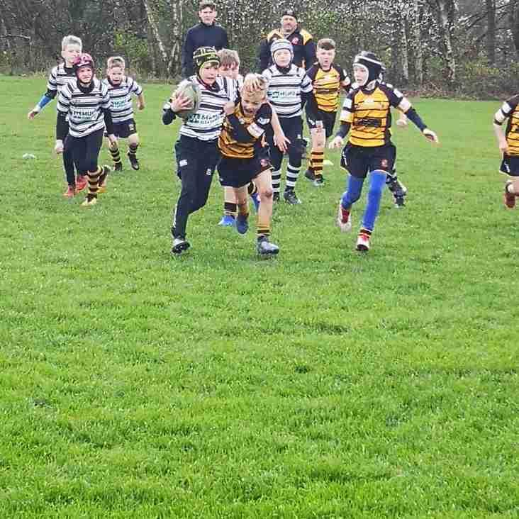 Orrell U9s enjoy a local derby vs Wigan on Sunday morning