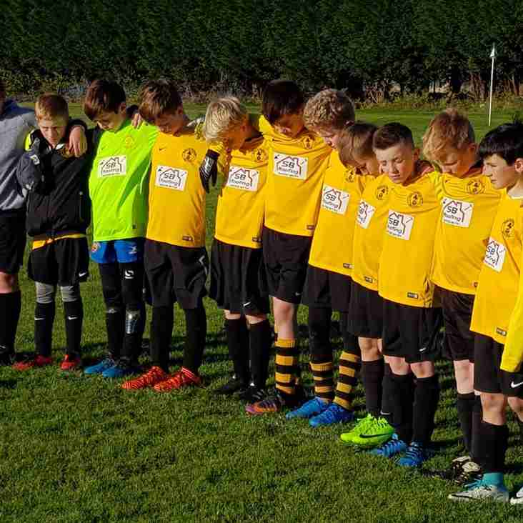Racing Club U11s observe a minute's silence