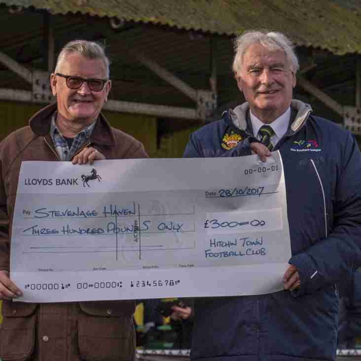 Barratt presents cheque