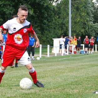 Nine-man Reds edged out