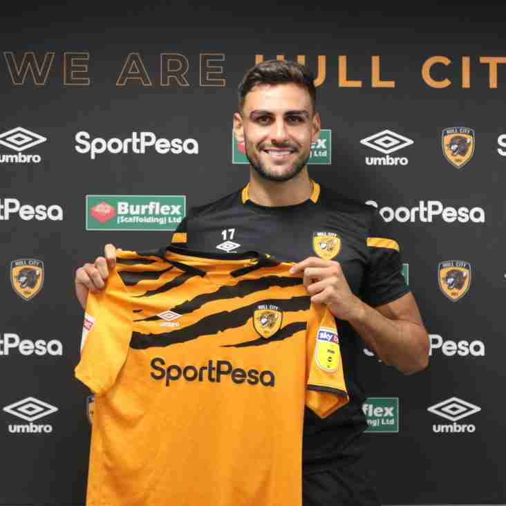 Trialist Tafazolli Signs Up