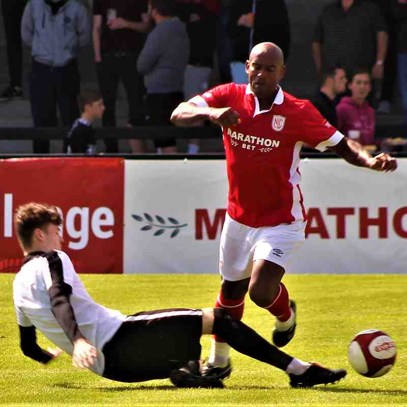 Ryan Bell tackles Trevor Sinclair