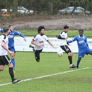 An off key Town get the Blues and fall to defeat on a grey day in Hertfordshire