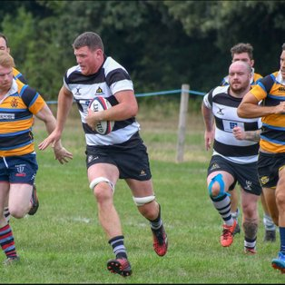 Farnham win bruising encounter