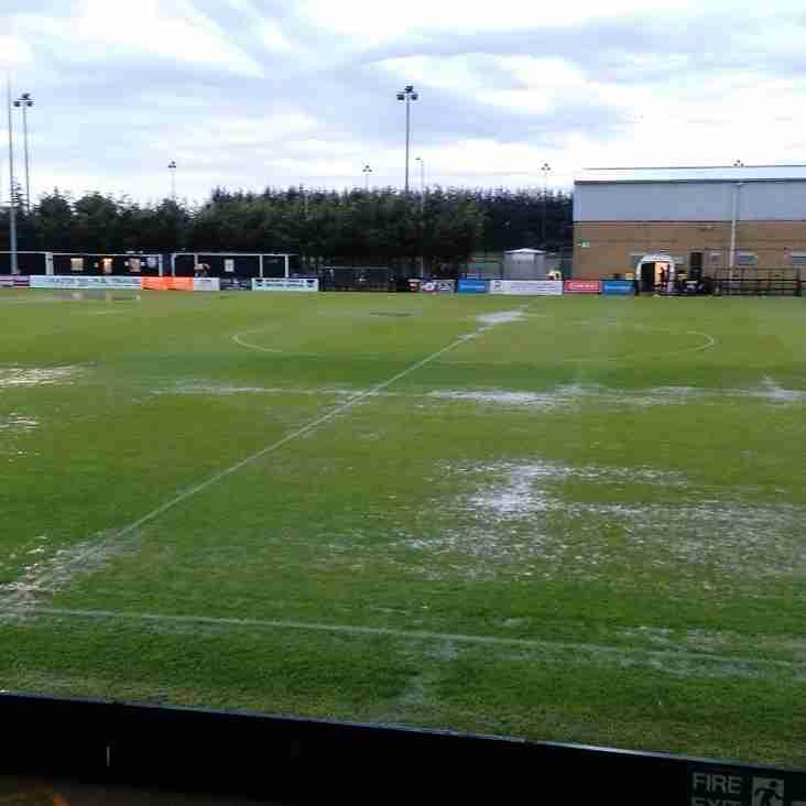 Summer storm floods pitch