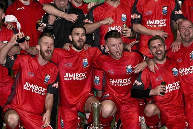 Cup winners: Brig celebrate with their silverware