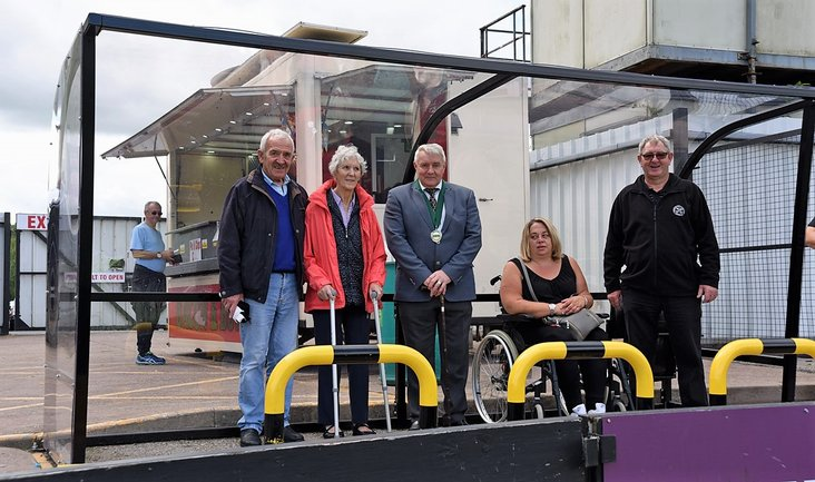 Sitting pretty: Harry and Chris Wilkes along with  Hednesford Town Council's Alan Pearson, fan Sam Freeman and Kevin Fearn who constructed the shelter