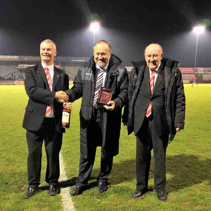 Leaders collect award before replay