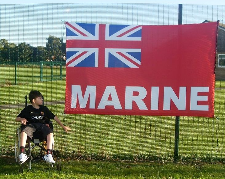 Proud Alfie with his Mariners flag