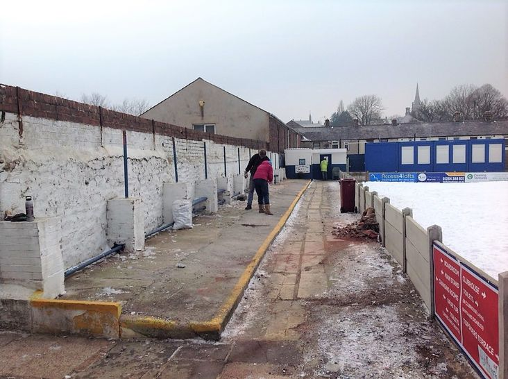 Job done: Officials check out their foundations for a new stand