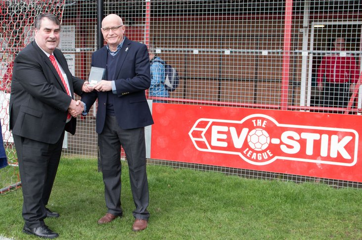Presentation time: Whites chairman Rob Bradley collects their award from league representative Dominic McKenzie