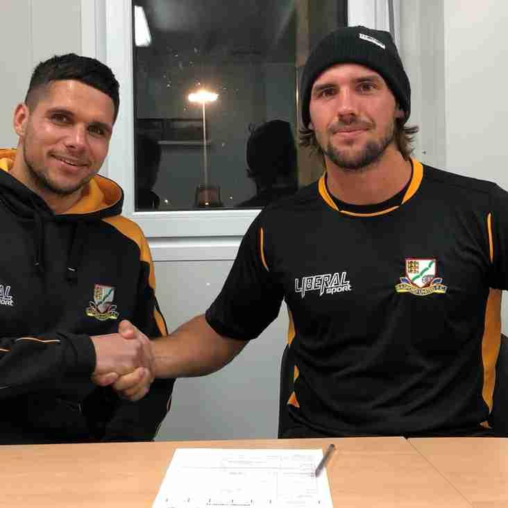 Wilson signs, Grantham returns