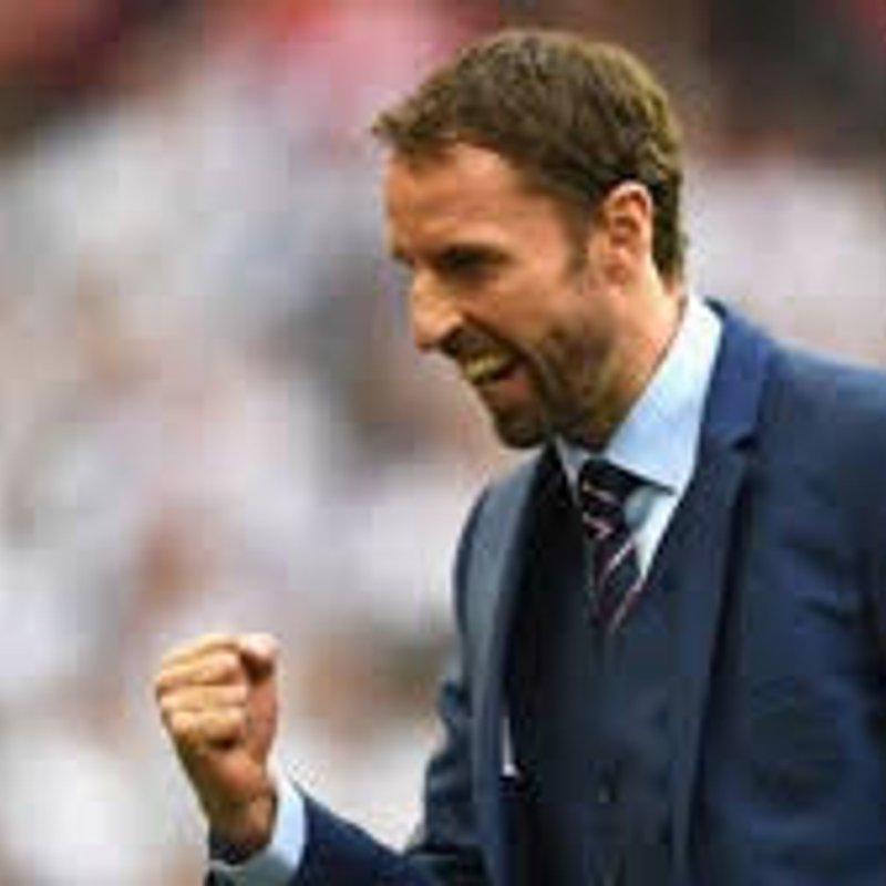 England Manager Gareth Southgate congratulates Parkwood Rangers FC
