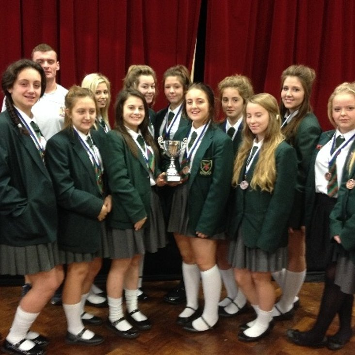 YEAR 9/10 GIRLS RECEIVE THEIR TROPHY<