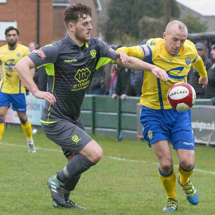 Michael Wilson (on left) agrees terms with Vics