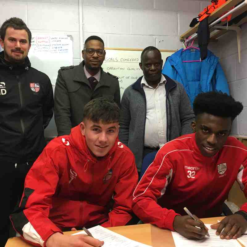 Enoch and Dylan signing on