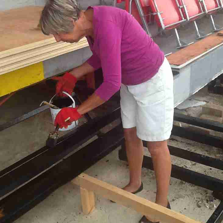 Stand maintenance continues at the Globe with help from volunteers.