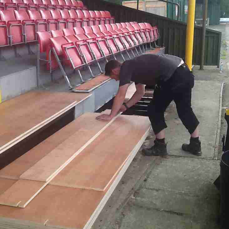 Volunteer Thomas Downer lends a hand with stand floor renovations at the Globe.
