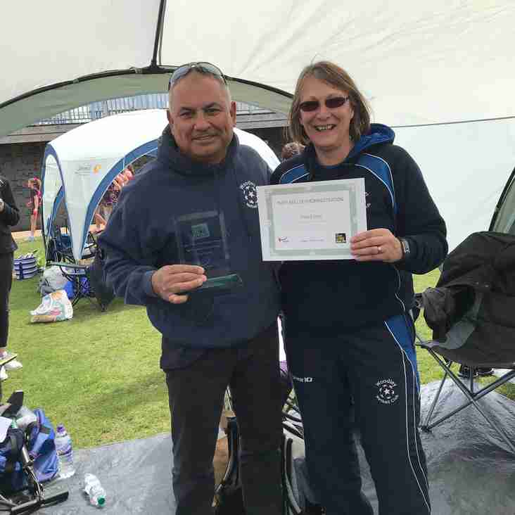 Sarah presenting Tony with Administrator the Year award