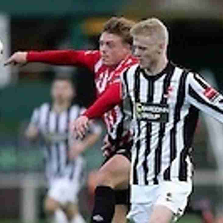 Frazer Blake-Tracy signs from Dereham Town